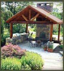 outdoor fireplace and kitchen under