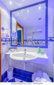 luxury bathroom blue light stock photo
