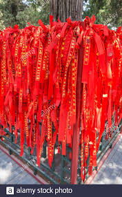 Beijing China May 22 2016 Many Red Ribbons With Chinese Characters And Signs Yin Yang Which Are Tied To The Fence Stock Photo Alamy