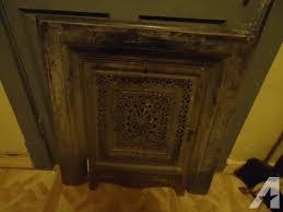 old antique cast iron fireplace door