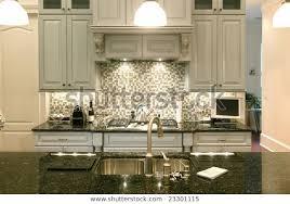 glass backsplash granite counter