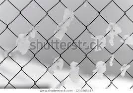 Frozen Mesh Chainlink Pieces Ice Snow Stock Photo Edit Now 1230205417
