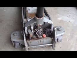 repair a floor jack that leaks fluid