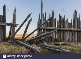 Old Wooden Fence With Sharp Tops On Bluff Overlooking Expansive Valley In Iceland Stock Photo Alamy