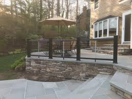 A Beautiful Composite Post And Cable Rail Fence On Blue Stone Patio Deck In Smithtown Patio Stones Bluestone Patio Patio Railing