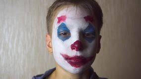 joker clown makeup on halloween stock