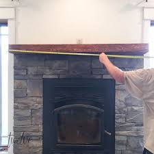 stone fireplace surround gets a