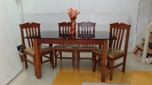 teak wood dining table set with glass