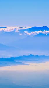 mounns blue sky clouds