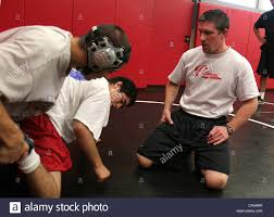 Byron Campbell, Palomar College wrestling coach, right, works on ...