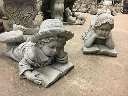 garden stone boy girl reading books
