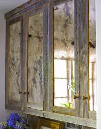 look mirrored cabinets distressed