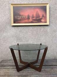 glass and teak circular round coffee table