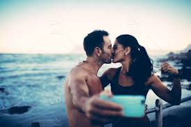cute fitness couple kissing each other
