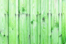 A Fragment Of A Wooden Fence Wooden Boards As A Background With Copy Space Wooden Rustic Wood Boards Background Texture Green Color Stock Photo C Mukhomedianova 104239614