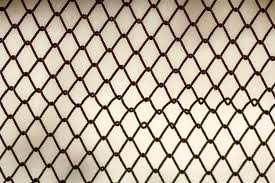 Premium Photo Background And Texture For Design Abstract Chain Link Fence Texture Against Grungy Gray Color Wall
