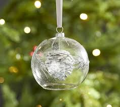 glass ball with pinecone