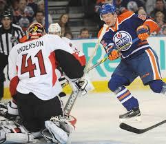 Iiro Pakarinen, right, fires on Ottawa Senators goalie Craig ...