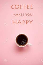 cup of black coffee on pink background quotes stock photo