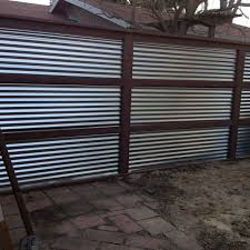 Corrugated Fencing Ideas Galvanized Corrugated Metal And Treated Wood Feature Wall Bartt Corrugated Metal Wall Wood Fence Corrugated Metal Fence