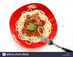 Spaghetti with tomato sauce on red plate, with fork Stock Photo ...