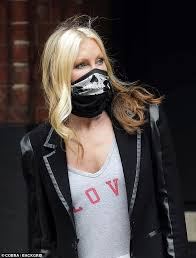ca sports face mask as she s left