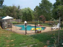 Black Chain Link Fence As A Pool Enclosure With Single Gate Black Chain Link Fence Chain Link Fence Pool Enclosures