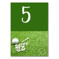 happy new year to golfer golf ball on green birthday table