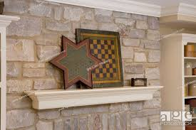 suspened mantel on a stone fireplace