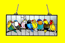 birds on wire stained glass panel