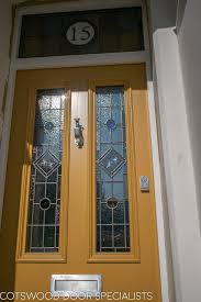 yellow victorian front door and frame