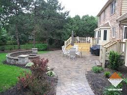 outdoor patio stone fireplace backyard