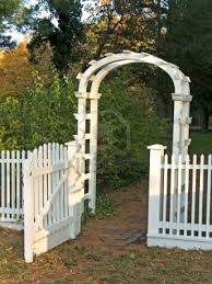 A White Garden Gate And Picket Fence Along With A Cobblestone Garden Gates Picket Fence Garden Cobblestone Walkway