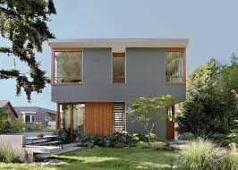 corrugated metal panels clad a house by