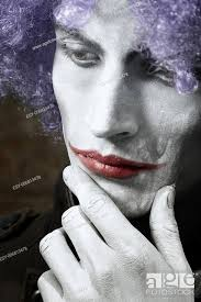 sad funny man with theatrical makeup