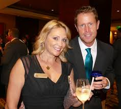 Suzanne Johnson, chair of the after-party, and her husband Ryan