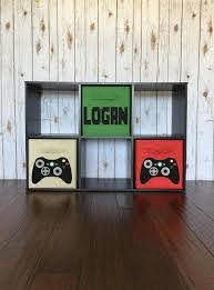 Great Idea For Setting Up A Gaming Station In A Bedroom The Tv And Console Can Sit On Top And The Bins Hold A Video Game Bedroom Video Game Decor Gamer