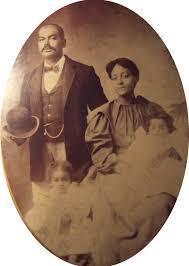 Studio shots, no. 28: Ned and Louisa Gay Barnes family. | Black Wide-Awake