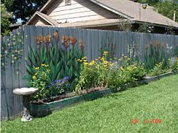 Fence Art 25 Pieces Of Art Using A Backyard Fence As The Canvas 100 Things 2 Do Garden Fence Art Backyard Fences Garden Mural
