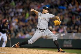 Dustin McGowan of the Miami Marlins pitches against the Colorado ...