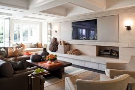 family room tv wall with fireplace and