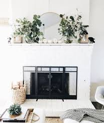 white painted brick fireplace with