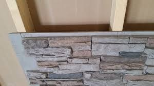 faux stone paneling to wall studs