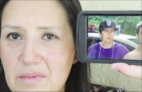 Marie-Eve Smith with an image of her murdered son Levi Marance on Wednesday  in Saskatoon.