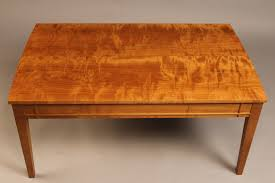 cherry wood coffee table with drawer