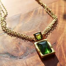 gold chain necklace with emerald green