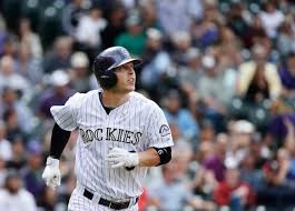 Corey Dickerson returns to Coors Field with Rockies and Rays still ...
