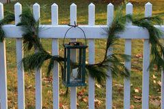 Rustic White Picket Fence With Green Boughs And Lantern Stock Image Image Of Visit Boughs 113615169