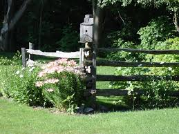 Cedar Rail Fence With Bird House And Garden Beautiful Farm Landscaping Corner Landscaping Landscaping Inspiration