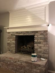 brick fireplace makeover with shiplap